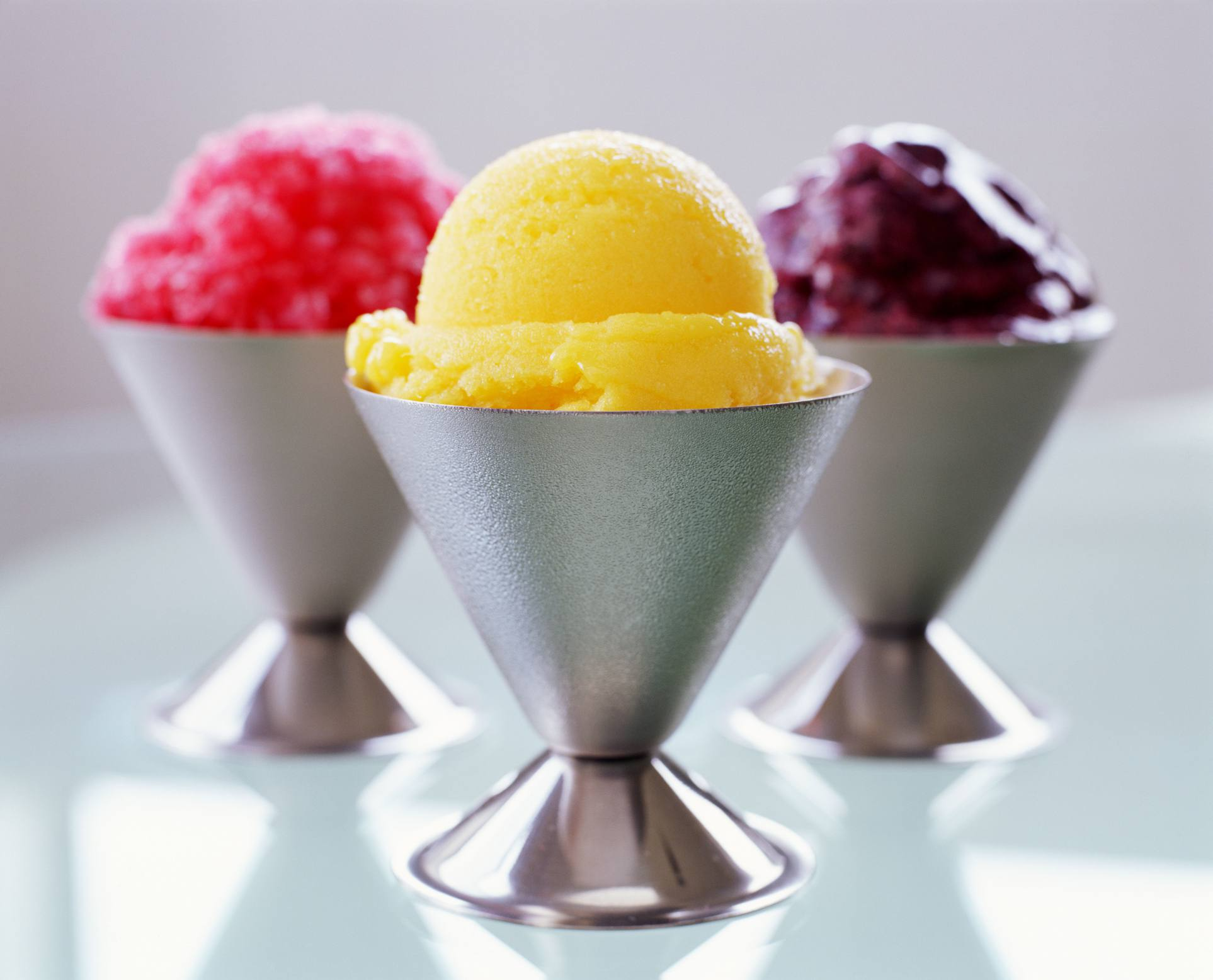 three different sorbets in dishes