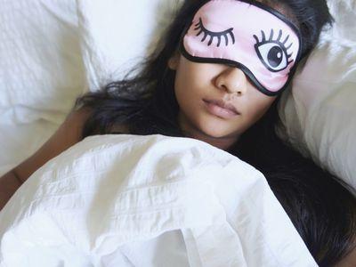 Woman sleeping with a sleep mask