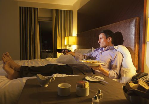 man eating in bed