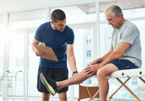 Undergoing Physical Therapy in Preparation for Knee Replacement Surgery