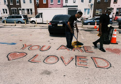 A man volunteers for Prevention Point Philadelphia and Step Up to the Plate in the Kensington neighborhood on July 19, 2021 in Philadelphia, Pennsylvania.