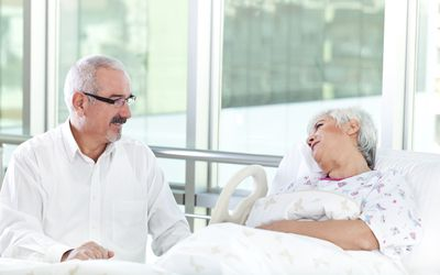 woman in hospital with comforting husband