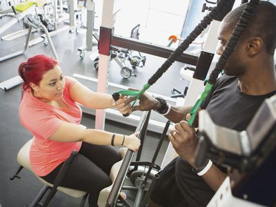 Woman doing physical therapy with trainer