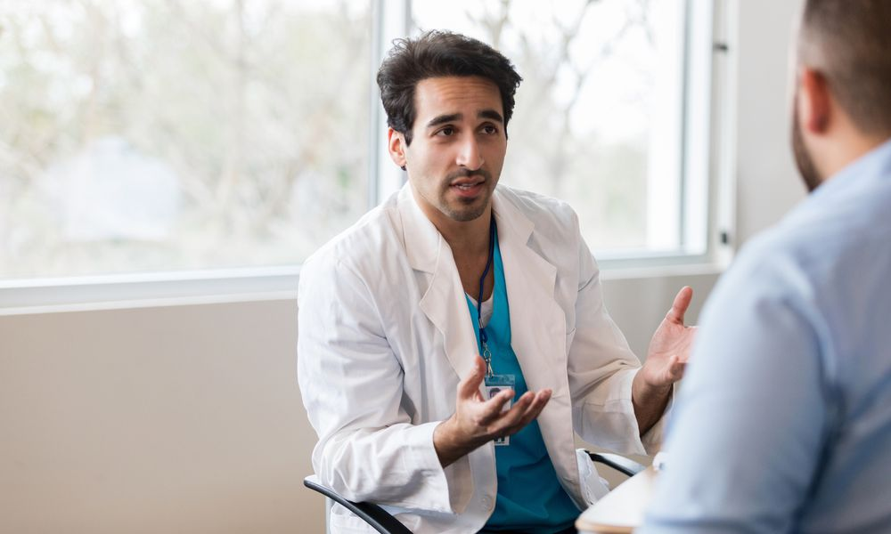 Doctor discusses something with patient