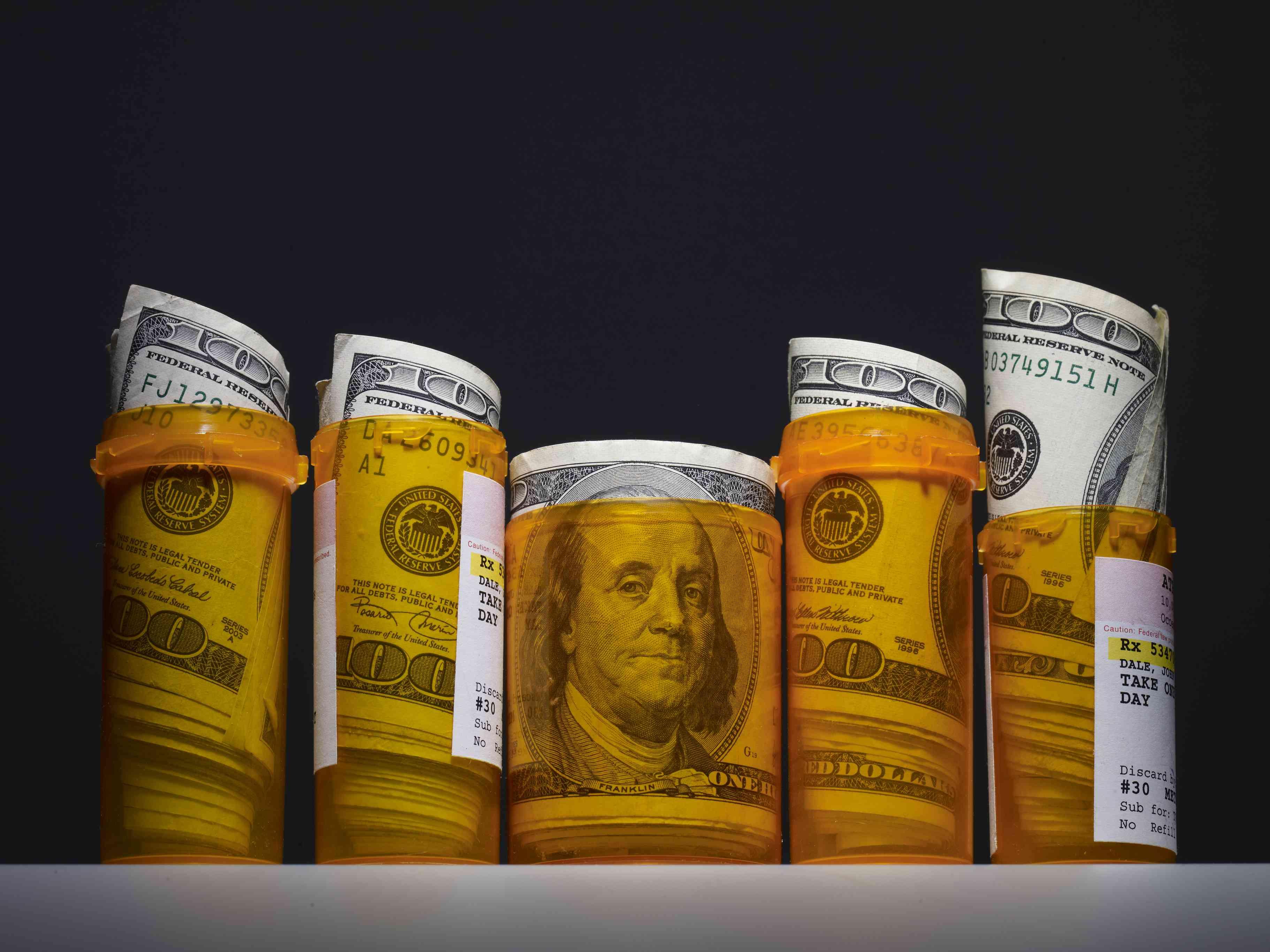 money in pill bottles