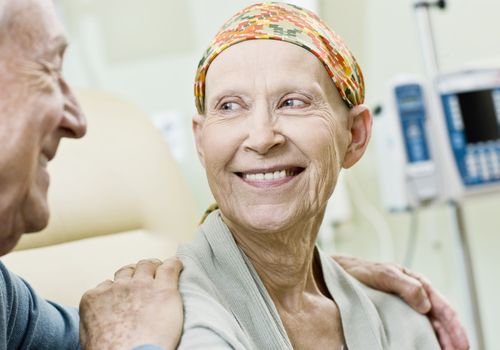 Chemotherapy patient smiling but wondering how to stay positive with cancer