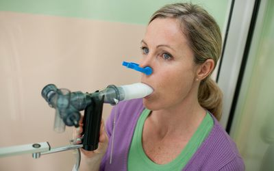 Woman undergoing a lung function test.
