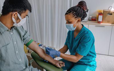 Nurse preparing patient to do a blood analysis - stock photo
