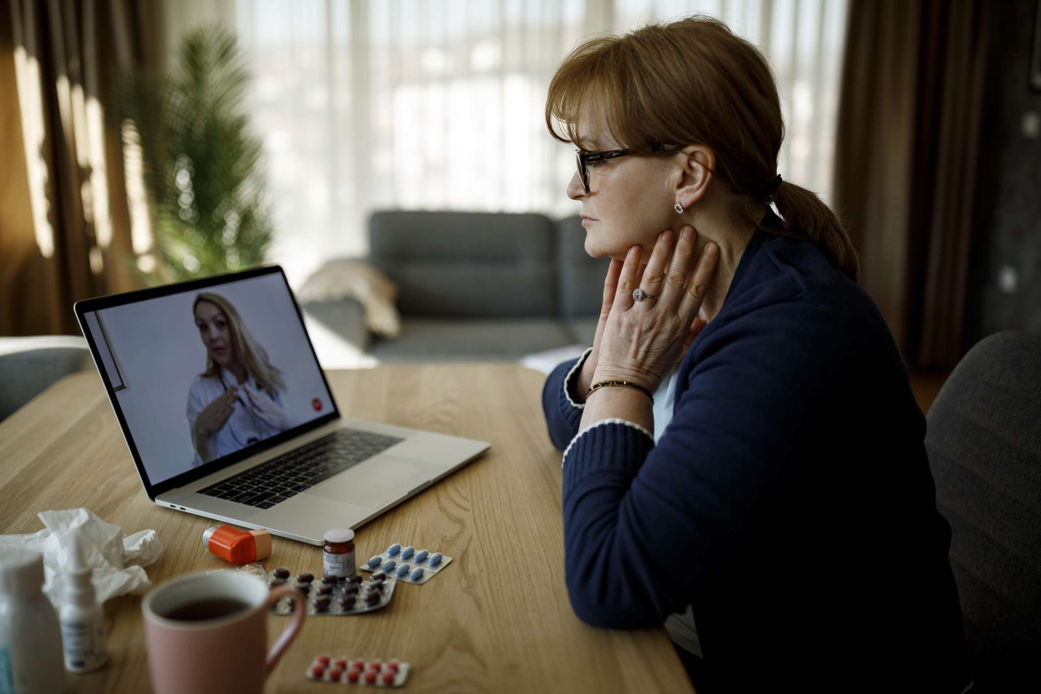 Women talking with doctor about thyroid disease during telehealth appointment