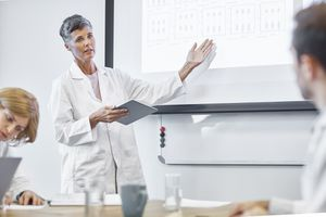 Female scientist discussing cancer treatments