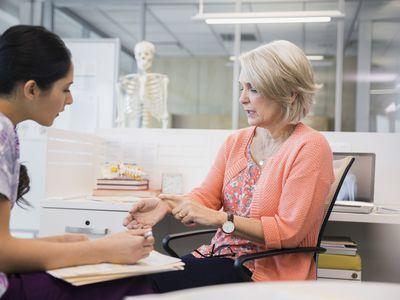 Patient explaining wrist pain to nurse in clinic