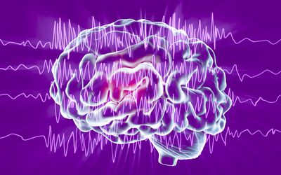 Illustration of a human brain with brainwaves on a purple background.