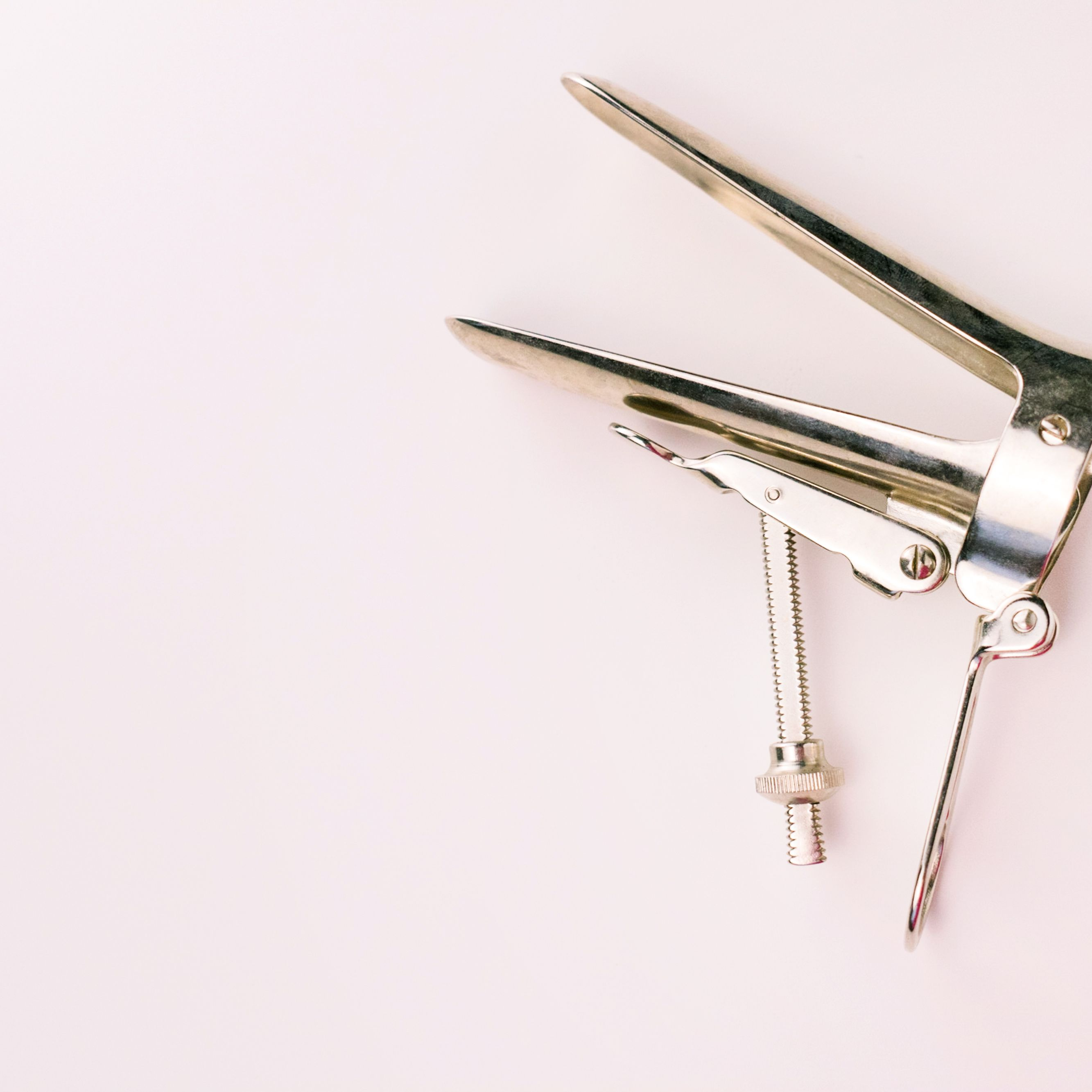 gynecological-mirror-on-a-white-background--copy-space-gynecological-examination-instrument--1223609658-990a83e77e7d4256922b88f54204441d.jpg