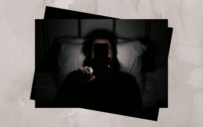 Person scrolling through their phone late at night.