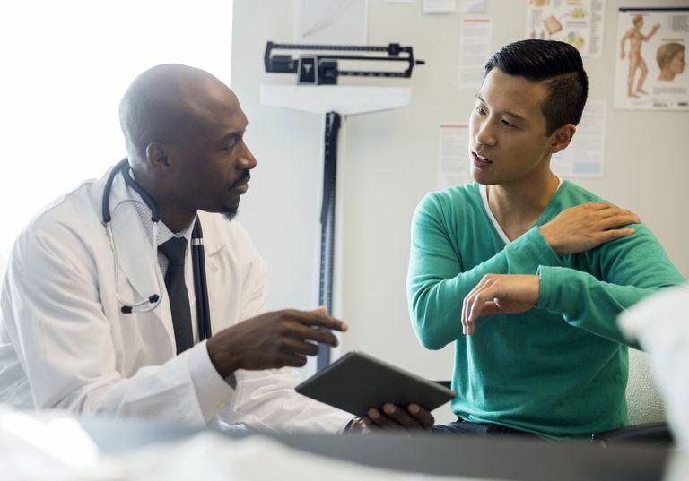 Doctor examining patient in pain