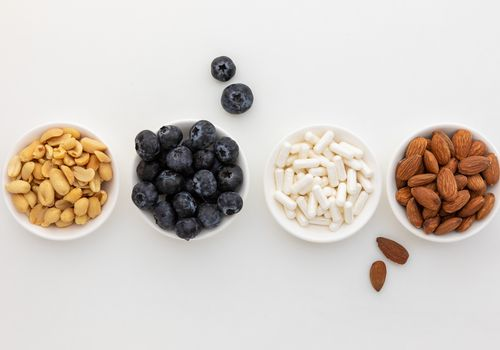 Pterostilbene capsules, blueberries, almonds, and peanuts