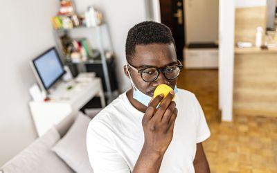 Man smelling lemon