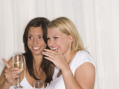 Two women laughing and pointing