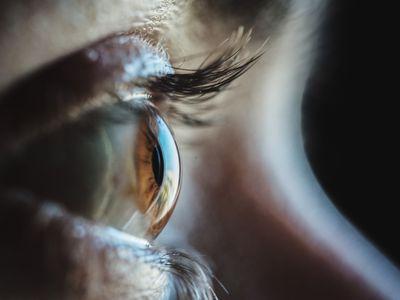Closeup, side view of a brown eye.