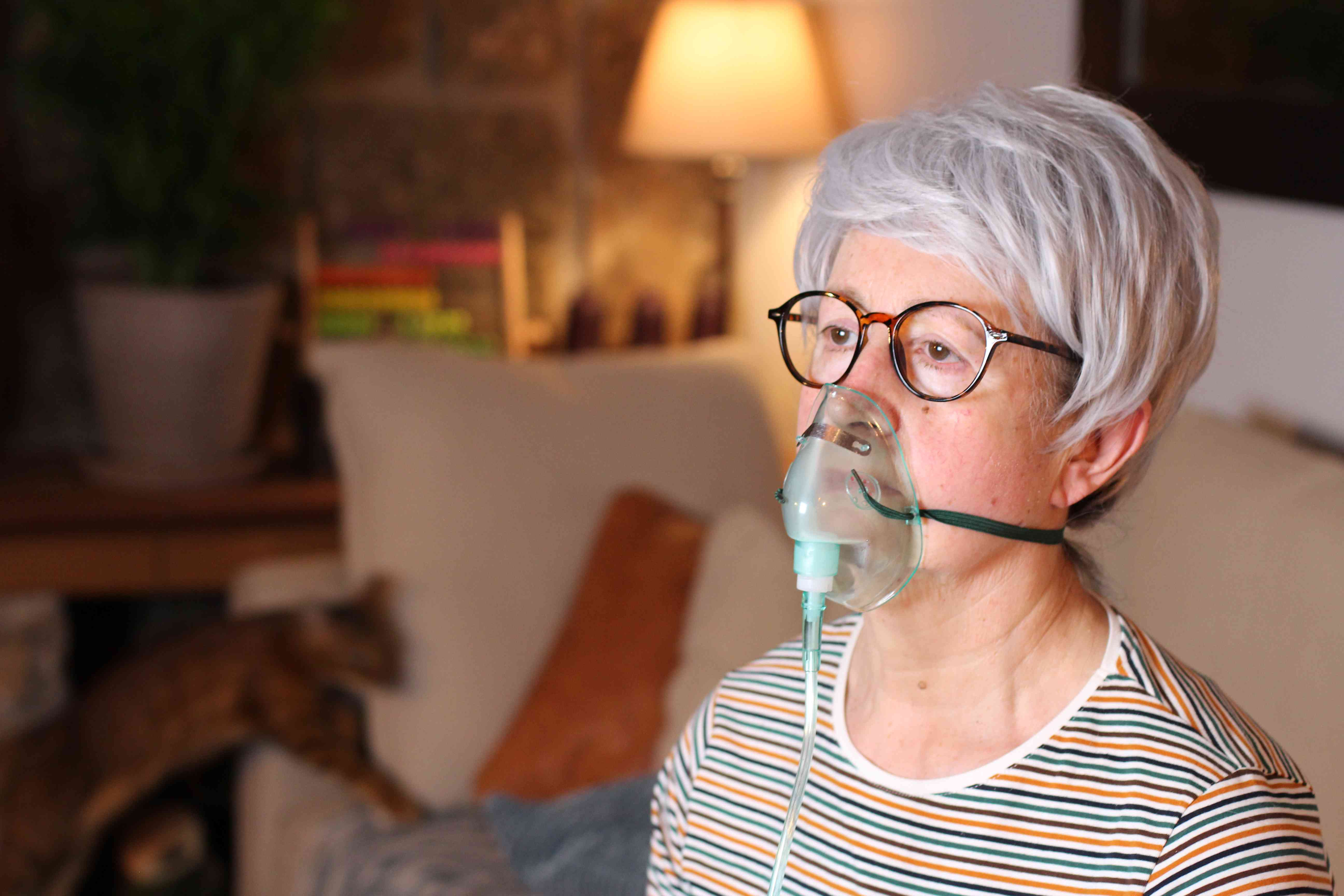 Senior woman receiving oxygen therapy