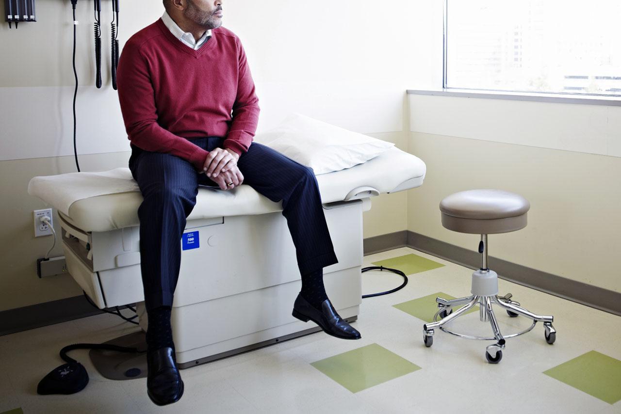 Man sitting on an exam room table