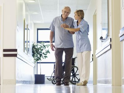 An ambulatory patient and his nurse.