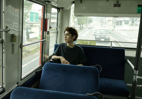 Young man alone on a bus