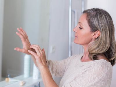Woman itching her hand.