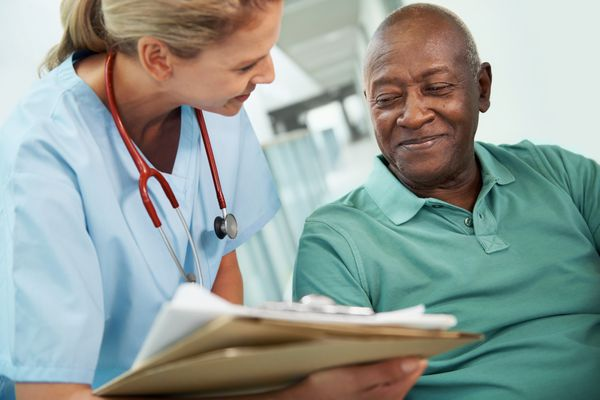 Smiling man and doctor discussing results
