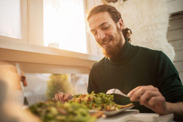 Young man enjoying salad